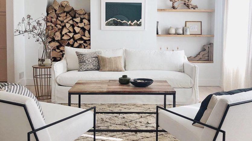 salon-scandinave-revisite-avec-du-metal-noir-sur-le-mobilier-maisons-aliénor-périgord-constructeur-maisons-individuelles